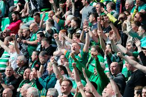 Celtic fans celebrate in the stands during the Ladbrokes Scottish Premiership match at Tynecastle Stadium, Edinburgh. PRESS ASSOCIATION Photo. Picture date: Sunday April 2, 2017. See PA story SOCCER Hearts. Photo credit should read: Andrew Milligan/PA Wire. EDITORIAL USE ONLY