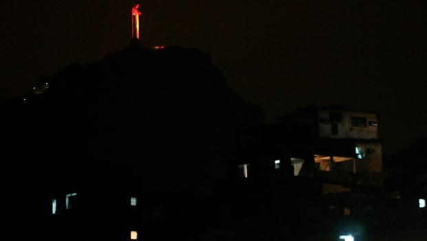 RIO DE JANEIRO, BRAZIL - SEPTEMBER 06:  Christ the Redeemer statue is lit in the colors of the Paralympic torch the night before the start of the Rio 2016 Paralympic Games, with the Cantagalo 'favela' commuity in the foreground, on September 6, 2016 in Rio de Janeiro, Brazil.  (Photo by Mario Tama/Getty Images)