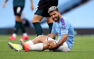 Sergio Aguero holds his knee after a Burnley foul which earned Manchester City a penalty during the 5-0 win..
