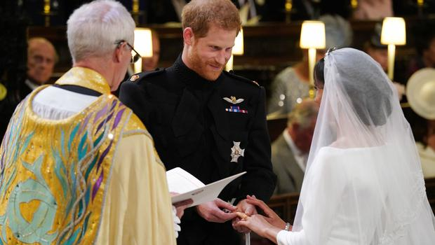 Prince Harry places the wedding ring on Meghan's finger (Jonathan Brady/PA)