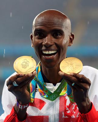 Great Britain's Mo Farah with his gold medals for victory in the Men's 5000m and 10000m on the fifteenth day of the Rio Olympics Games, Brazil. Photo:Martin Rickett/PA Wire