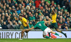 Australia's Sefanaia Naivalu gets past Ireland's Conor Murray on his way to scoring a try during the Autumn International match at the Aviva Stadium, Dublin. PRESS ASSOCIATION Photo. Picture date: Saturday November 26, 2016. See PA story RUGBYU Ireland. Photo credit should read: Brian Lawless/PA Wire. RESTRICTIONS: Editorial use only, No commercial use without prior permission