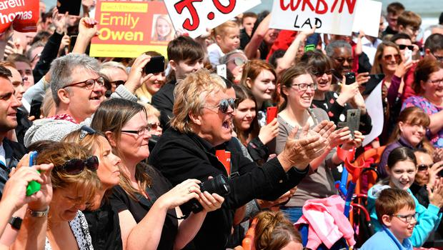 UNSPECIFIED, UNITED KINGDOM - JUNE 07:  Supporters applaud as Labour party leader Jeremy Corbyn arrives to speak on the Promenade on June 7, 2017 in Colwyn Bay, Denbighshire, United Kingdom. The Labour leader is holding six rallies across Scotland, England and Wales today on the final day before polling day in the General Election  (Photo by Anthony Devlin/Getty Images)