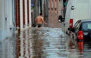 A man stands in the flooded street in underwear as the city is flooded due to heavy rainfalls at Montargis, central France, on June 01, 2016.AFP/Getty Images