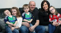 Richard Clarke at home in Castlederg with his wife Karen and children, Abbey, Emily, Seth and Jacob. Pic by Peter Morrison