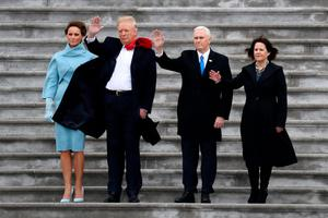 WASHINGTON, DC - JANUARY 20:  First Lady Melania Trump, President Donald Trump, Vice President Mike Pence and Karen Pence wave goodbye to Barack and Michelle Obama on the West Front of the U.S. Capitol on January 20, 2017 in Washington, DC. In today's inauguration ceremony Donald J. Trump becomes the 45th president of the United States.  (Photo by Rob Carr/Getty Images)