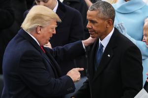 President Donald Trump points at Former President Barack Obama after his speech during the 58th Presidential Inauguration at the U.S. Capitol in Washington, Friday, Jan. 20, 2017. (AP Photo/Andrew Harnik)