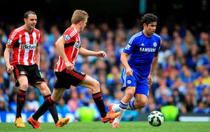 Chelsea's Diego Costa (right) in action with Sunderland's Sebastian Larsson (centre) and John O'Shea during the Barclays Premier League match at Stamford Bridge, London. Nick Potts/PA Wire.