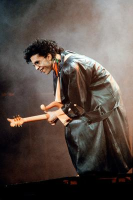 This photo taken on June 17, 1987 shows musician Prince performing onstage during his concert at the Bercy venue in Paris.   Pop icon Prince -- whose pioneering brand of danceable funk made him one of music's most influential figures -- died on April 21, 2016 at his compound in Minnesota. He was 57. The announcement came just a week after the Grammy and Oscar winner was taken to hospital with a bad bout of influenza, although he made light of his health problems after the scare.   / AFP PHOTO / Bertrand GUAYBERTRAND GUAY/AFP/Getty Images