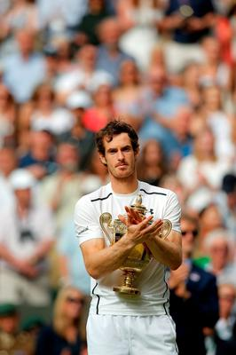 LONDON, ENGLAND - JULY 10:  Andy Murray of Great Britain holds the trophy following victory in the Men's Singles Final against Milos Raonic of Canada on day thirteen of the Wimbledon Lawn Tennis Championships at the All England Lawn Tennis and Croquet Club on July 10, 2016 in London, England.  (Photo by Andy Couldridge-Pool/Getty Images)
