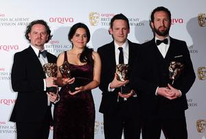 Left to right. Rupert Houseman, Sarah Hampton, Ben Anthony and Morgen Matthews with the Single Documentary Award for 7/7 One Day in London at the 2013 Arqiva British Academy Television Awards at the Royal Festival Hall, London. PRESS ASSOCIATION Photo. Picture date: Sunday May 12, 2013. See PA story SHOWBIZ Bafta. Photo credit should read: Ian West/PA Wire