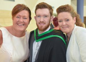 Diarmuid McGrillen  from Killyleagh graduating in Sports Science, pictured at the Ulster University Summer Graduation at the Waterfront Hall in Belfast along with Dolores Blythe (L) and Sarah McGrillen. Photo by Aaron McCracken
