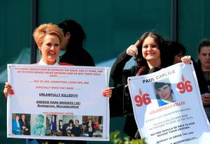 WARRINGTON, ENGLAND - APRIL 26: Donna Miller (R), sister of Hillsborough victim Paul Carlile gives the thumbs up as she departs Birchwood Park after hearing the conclusions of the Hillsborough inquest on April 26, 2016 in Warrington, England. The fresh inquests into the 1989 Hillsborough disaster, in which 96 football supporters were crushed to death, concluded on April 26, 2016 with a verdict of unlawful killing, after the initial verdicts were quashed. Relatives of Liverpool supporters who died in Britain's worst sporting disaster gathered in the purpose-built court to hear the jury's verdict in Warrington after a 25 year fight to overturn the accidental death verdicts handed down at the initial 1991 inquiry.  (Photo by Christopher Furlong/Getty Images)