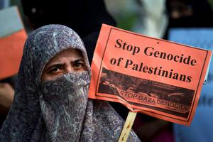 A woman supporter of Jamaat-e-Islami takes part in a demonstration against the Israeli bombings in the Gaza strip, in Islamabad, Pakistan, Saturday, July 26, 2014. (AP Photo/Anjum Naveed)