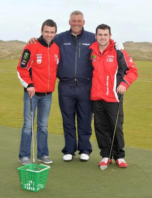 PACEMAKER, BELFAST, 15/5/2013: William and Michael Dunlop with Darren Clarke during a visit to Royal Portrush Golf Club. The brothers were taking a break from their North West 200 duties to have an impromptu golf lesson with the former British Open winner as part of a BBC Sport event. PICTURE BY STEPHEN DAVISON