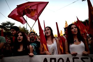 "Supporters of Greece's Comunist Party KKE shout slogans during a demonstration in Athens on July 2, 2015. General Secretary of the KKE called his party's supporters to vote with an invalid ballot at on the July 5 referendum seen as decisive for the nearly insolvent EU country's political and financial future.  Greece's left-wing government ""may very well"" resign if a referendum this weekend on bailout conditions results in a 'Yes' vote, Finance Minister Yanis Varoufakis said in a radio interview. AFP PHOTO / ARIS MESSINISARIS MESSINIS/AFP/Getty Images"