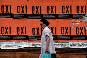 "TOPSHOTS A woman walks past posters reading 'NO' ahead of a referendum in Athens on July 2, 2015. Greece's left-wing government ""may very well"" resign if a referendum this weekend on bailout conditions results in a 'Yes' vote, Finance Minister Yanis Varoufakis said in a radio interview on July 2. AFP PHOTO / ARIS MESSINISARIS MESSINIS/AFP/Getty Images"
