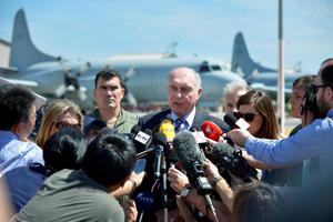 PERTH, AUSTRALIA - MARCH 22:  Acting Prime Minister of Australia Warren Truss speaks to the media at the RAAF Pearce Base on March 22, 2014 in Perth, Australia. The search to identify whether two large objects spotted via satellite in the Indian Ocean are related to missing flight MH370 continues today, for the third day, with no results. The airliner went missing two weeks ago carrying 239 passengers and crew on route from Kuala Lumpur to Beijing.  (Photo by Alf Sorbello - Pool/Getty Images)