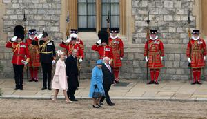 (left to right) Sabina Higgins, wife of the Irish President, Prince Philip, Queen Elizabeth II and the the President of Ireland, Michael D Higgins inspect the guard at Windsor Castle, Berkshire during the first State visit to the UK by an Irish President
