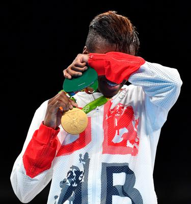 Great Britain's Nicola Adams poses on the podium with a gold medal during the Rio 2016 Olympic Games at the Riocentro - Pavilion 6 in Rio de Janeiro on August 20, 2016.   / AFP PHOTO / Yuri CORTEZYURI CORTEZ/AFP/Getty Images