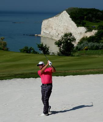 KAVARNA, BULGARIA - MAY 19:  Graeme McDowell of Northern Ireland plays his second shot on the fourth hole during the semi-final of the Volvo World Match Play Championship at Thracian Cliffs Golf & Beach Resort on May 19, 2013 in Kavarna, Bulgaria.  (Photo by Andrew Redington/Getty Images)