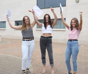 PACEMAKER PRESS 15/8/2019 A Level Students Katie Dowds, Louise McAnea and Victoria Catterson Grosvenor Grammar School. There has been a rise in the proportion of top A-level grades awarded to pupils in Northern Ireland. About 28,000 students received their A-level and AS-level results on Thursday morning. Just over 30% of entries were awarded A* or A grades, a rise of half a per cent on 2018. Photo by Laura Davison/Pacemaker Press