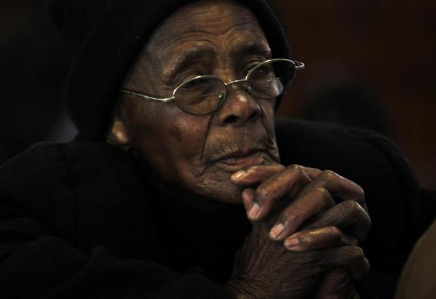 A worshipper at morning mass at the Regina Mundi Catholic Church in Soweto, Sunday June 9, 2013. Churchgoers  were urged to pray for former president Nelson Mandela after he was hospitalized with a recurring lung infection. (AP Photo/Denis Farrell)