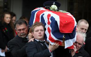 Murdered prison officer David Black's son Kyle carries his coffin after the funeral service in November 2012 (Paul Faith/PA)