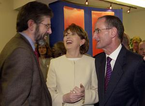 PACEMAKER BELFAST  15/2/2000:  President Mary McAleese and her husband, Martin share a joke with Gerry Adams, the M.P. for West Belfast,  when she visited the Glor na Ghale Irish language centre on the Fall's Road, Belfast today. PICTURE BY STEPHEN DAVISON