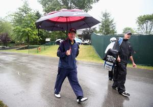 LOUISVILLE, KY - AUGUST 08:  Tom Watson of the United States and his caddie Neil Oxman walk to the practice ground during the weather-delayed second round of the 96th PGA Championship at Valhalla Golf Club on August 8, 2014 in Louisville, Kentucky.  (Photo by Warren Little/Getty Images)