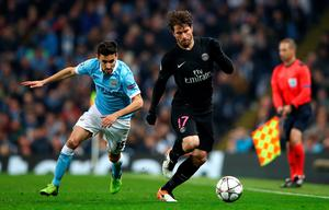 MANCHESTER, ENGLAND - APRIL 12:  Maxwell of Paris Saint-Germain is chased by Jesus Navas of Manchester City during the UEFA Champions League quarter final second leg match between Manchester City FC and Paris Saint-Germain at the Etihad Stadium on April 12, 2016 in Manchester, United Kingdom.  (Photo by Clive Brunskill/Getty Images)