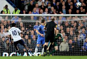 LONDON, ENGLAND - MAY 08:  Emanuel Adebayor #10 of Spurs scores from long range to level the scores at 1-1 during the Barclays Premier League match between Chelsea and Tottenham Hotspur at Stamford Bridge on May 8, 2013 in London, England.  (Photo by Ian Walton/Getty Images)