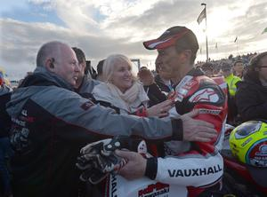PACEMAKER BELFAST, 16-05-13: Jeremy McWilliams celebrates winning the Supertwins race at the Vauxhall International North West 200 this evening with his wife Jill and NW Event Director Mervyn Whyte. PICTURE BY STEPHEN DAVISON