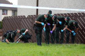 PACEMAKER, BELFAST, 16/6/2020: Police search at the scene of an overnight shooting in which a house was attacked in Orkney Drive, Ballymena. PICTURE BY STEPHEN DAVISON