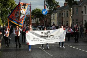Bandsmen and members of the Orange Order pictured at a PSNI barrier at the Woodvale Road in North Belfast after the main 12th of July parades took place across Northern Ireland. This year, as has been the case since 2013, the feeder parade was not allowed to return by the same route on Tuesday evening. Photo by Kelvin Boyes / Press Eye.