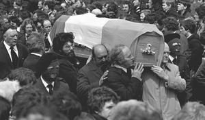 PACEMAKER BELFAST   ARCHIVE     15th May 1981 Funeral of IRA hunger striker Frances Hughes in his home town of Bellaghy..\  Gerry Adams carrys the coffin flanked by masked IRA men