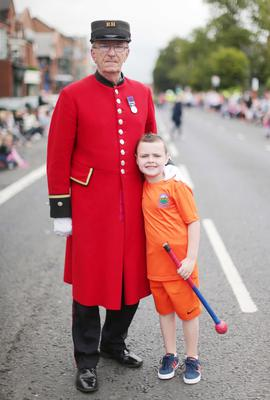 Press Eye - Belfast -  Northern Ireland - 13th July  2015  Belfast's Orange Order annual 12th of July demonstration makes its way through the City Centre to the field at Malone House beside Shaws Bridge.  Chelsea Pensioner Sam Cameron and seven-year-old Conor Boyd wait for the parade on the Lisburn Road.   Picture by Jonathan Porter/Press Eye