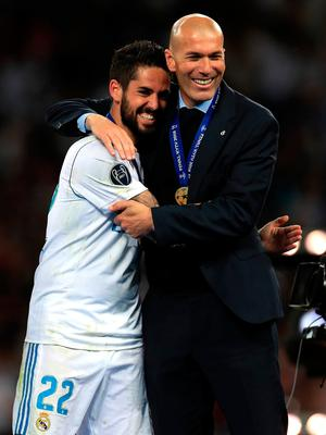 Real Madrid manager Zinedine Zidane (right) and Alarcon Isco (left) celebrate winning the UEFA Champions League Final at the NSK Olimpiyskiy Stadium, Kiev. PRESS ASSOCIATION Photo. Picture date: Saturday May 26, 2018. See PA story SOCCER Champions League. Photo credit should read: Mike Egerton/PA Wire