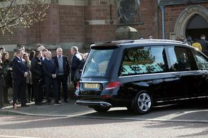 The hearse carrying the coffin of Reece Leeman arrives at St Mark's Church for the funeral in east Belfast.