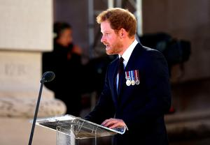 Prince Harry gives a reading as part of a military-led vigil to commemorate the 100th anniversary of the beginning of the Battle of the Somme at the Thiepval memorial to the Missing, as part of the Commemoration of the Centenary of the Battle of the Somme at the Commonwealth War Graves Commission Thiepval Memorial in Thiepval, France, where 70,000 British and Commonwealth soldiers with no known grave are commemorated. PRESS ASSOCIATION Photo. Picture date: Thursday June 30, 2016. See PA story HERITAGE Somme. Photo credit should read: Yui Mok/PA Wire