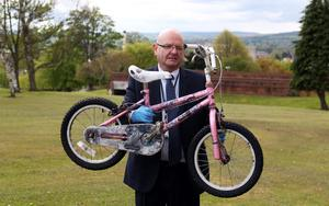File photo dated 16/5/2013 of DC Fred Hunter from the media crime unit holding a bike belonging to April Jones' friend, (who cannot be named), in Mold, north Wales, as the jury has today viewed a car belonging to murder suspect Mark Bridger and the bike that was being ridden by schoolgirl April Jones on the night she went missing. Former slaughterhouse worker Mark Bridger has been found guilty of abducting and murdering schoolgirl April Jones