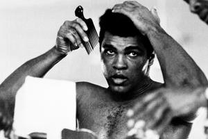 """This file photo taken on October 19, 1974 shows US boxing heavyweight champion Muhammad Ali (born Cassius Clay) 11 days before the heavy weight world championship  in Kinshasa.  Boxing icon Muhammad Ali died on Friday, June 3, a family spokesman said in a statement. """"After a 32-year battle with Parkinsons disease, Muhammad Ali has passed away at the age of 74,"""" spokesman Bob Gunnell said. / AFP PHOTO / STRINGERSTRINGER/AFP/Getty Images"""