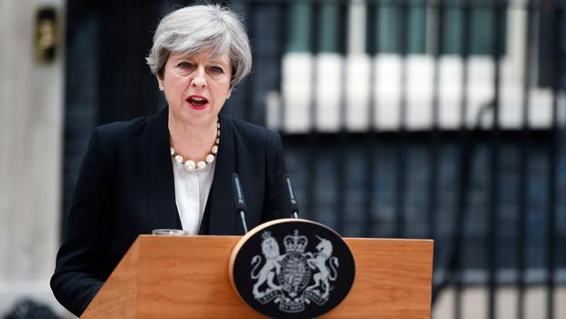 Prime Minister Theresa May addresses the media in Downing Street, London, after a suicide bomber killed 22 people, including children, as an explosion tore through fans leaving a pop concert in Manchester.