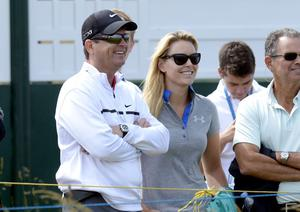 Lindsey Vonn watches Tiger Woods during practice day one for the 2013 Open Championship at Muirfield Golf Club, East Lothian