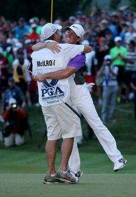 Rory McIlroy of Northern Ireland celebrates his one-stroke victory on the 18th green with his caddie J.P. Fitzgerald during the final round of the 96th PGA Championship at Valhalla Golf Club on August 10, 2014 in Louisville, Kentucky.  (Photo by Andrew Redington/Getty Images)