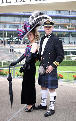 Racegoers Mimi Theobald and her husband Douglas from Inverness during Ladies' Day of the Royal Ascot meeting at Ascot Racecourse, Berkshire. PRESS ASSOCIATION Photo. Picture date: Thursday June 20, 2013. See PA story RACING Ascot. Photo credit should read: Steve Parsons/PA Wire