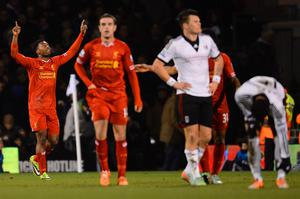 Daniel Sturridge of Liverpool celebrates scoring their first goal during the Barclays Premier League match between Fulham and Liverpool at Craven Cottage on February 12, 2014 in London, England