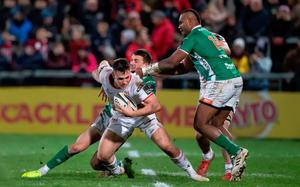 Gripping stuff: Ulster's James Hume is held up