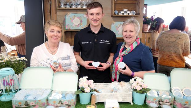 Press Eye - Belfast - Northern Ireland - 17th May 2018  Second day of the 2018 Balmoral Show, in partnership with Ulster Bank, at Balmoral Park.  Anne Matthews and Betty Rodgers from A Blissful Blend pictured with Nick McCafferty Entrepreneur Development Apprentice at Ulster Bank.  A Blissful Blend  was one of the companies provided with free space by Ulster Bank to exhibit in its marquee. The companies include Ulster Bank customers and entrepreneurs from the bank's Entrepreneur Accelerator.  Picture by Jonathan Porter/PressEye