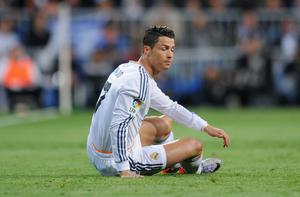Cristiano Ronaldo of Real Madrid looks dejected during the La Liga match between Real Madrid CF and FC Barcelona at the Bernabeu on March 23, 2014 in Madrid, Spain.  (Photo by Denis Doyle/Getty Images)